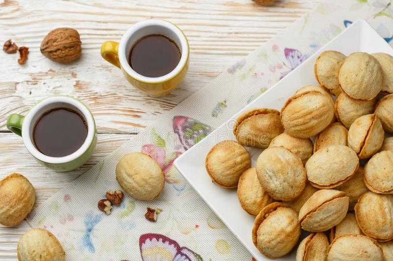 Cookies nuts with condensed milk and Turk with coffee on a wooden table in vintage style stock images