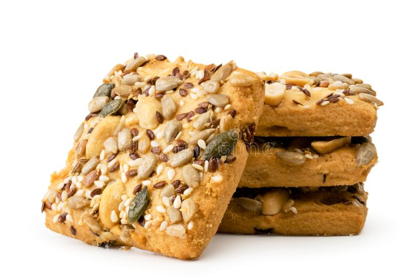 Cookies with nuts and seeds closeup on a white. Isolated. royalty free stock image