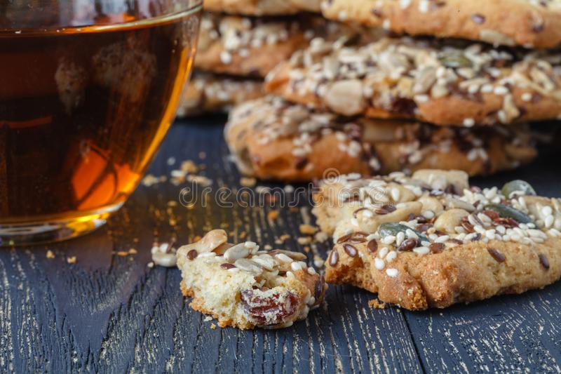 Cookies with nuts and seeds on table royalty free stock photo