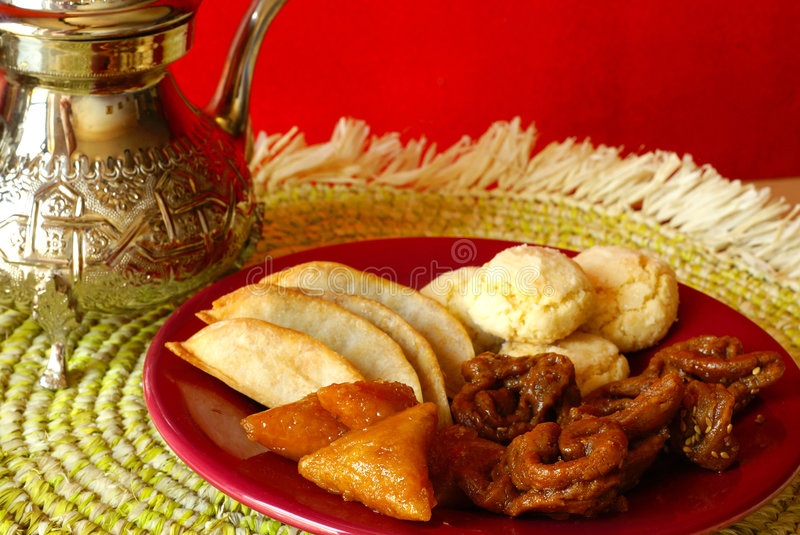 Cookies for Ramadan. Traditional Moroccan cookies served during Ramadan and teapot stock photo