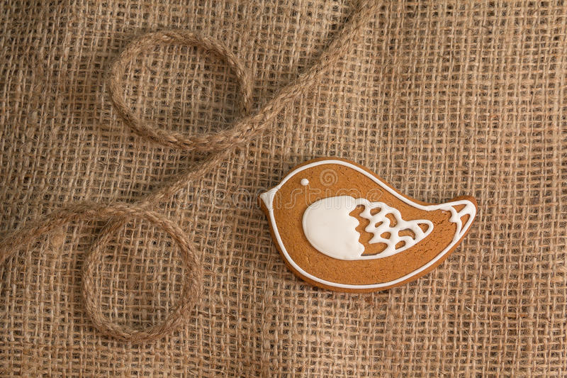 Cookies in the shape of a bird on a textile background stock photo