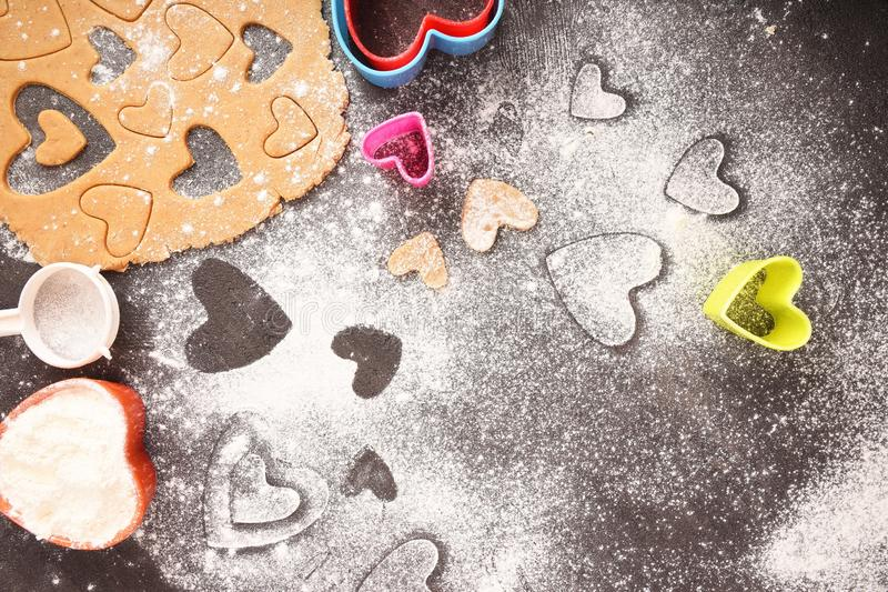 Cookies in the shape of hearts, cooking. Valentine`s Day. Flat lay. royalty free stock photo