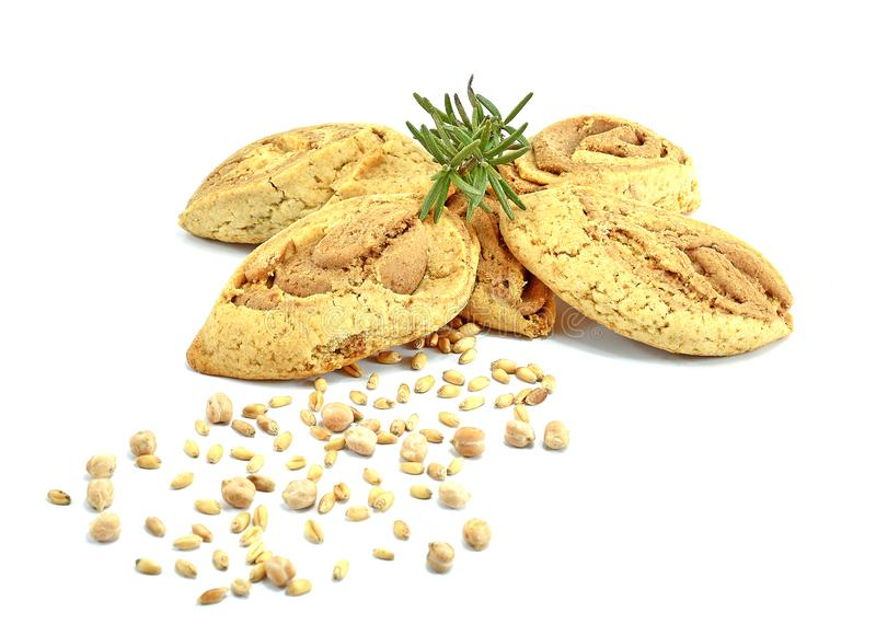 Cookies of soybeans and grains of wheal with twig of rosemary on white background royalty free stock photography