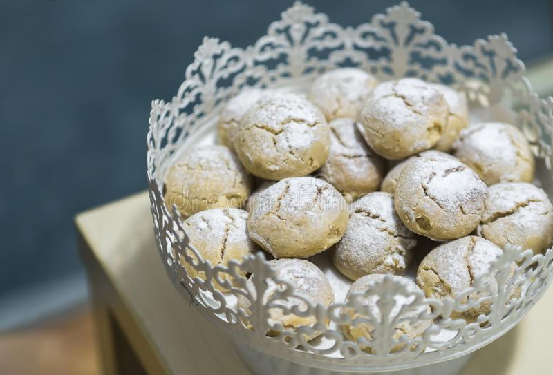 Cookies standing in a metal pie plate coated with powdered sugar and more.  royalty free stock images