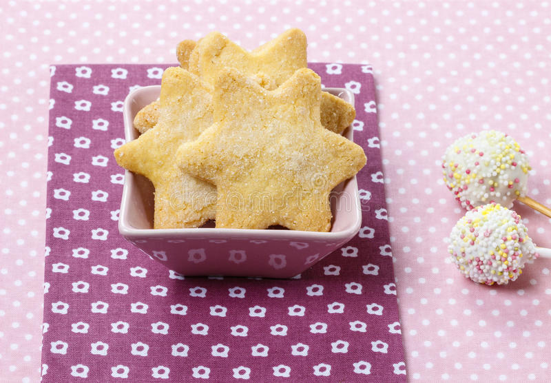 Cookies in star shape and white cake pops royalty free stock photos