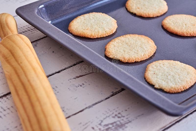 Cookies taken from the oven on a table royalty free stock photos