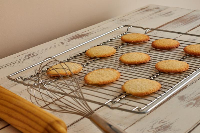 Cookies taken from the oven on a table royalty free stock photography