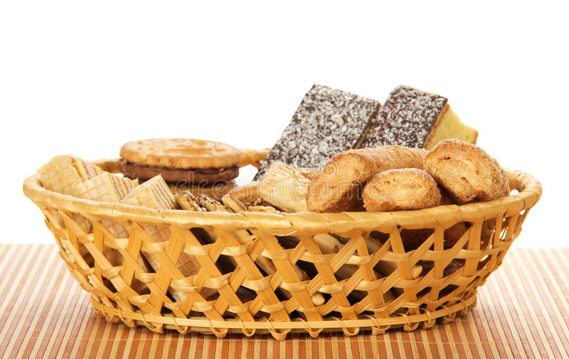 Cookies in a wattled basket on the bamboo cloth stock images