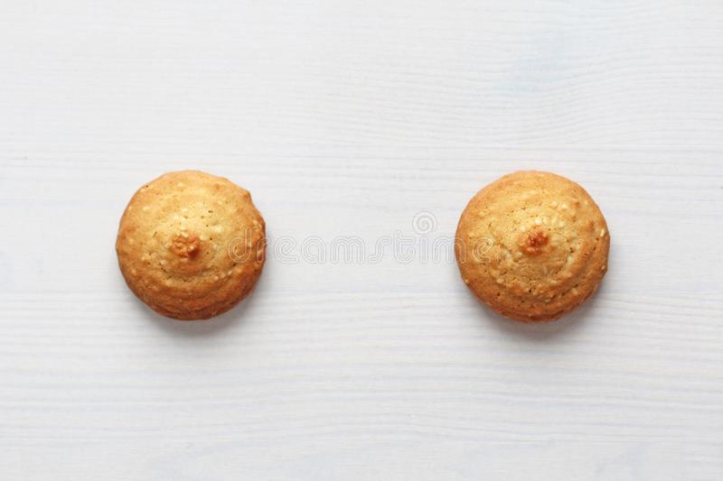 Cookies on a white background, similar to female nipples. nipples in the form of cookies. Humor, double meaning stock image