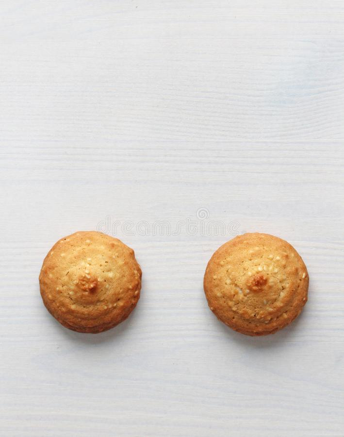 Cookies on a white background, similar to female nipples. Sexy nipples in the form of cookies. Humor, double meaning stock photo