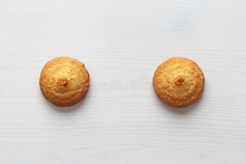 Cookies on a white background, similar to female nipples. Sexy nipples in the form of cookies. Humor, double meaning royalty free stock images
