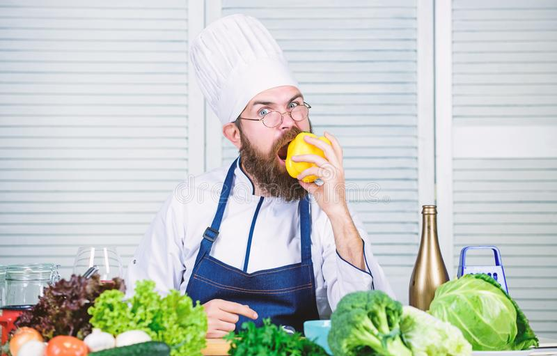 Cooking as hobby and professional occupation. Colorful culinary. Vegetarian diet concept. Chef cooking sweet pepper. Man. Wear apron cooking in kitchen. Man stock photos