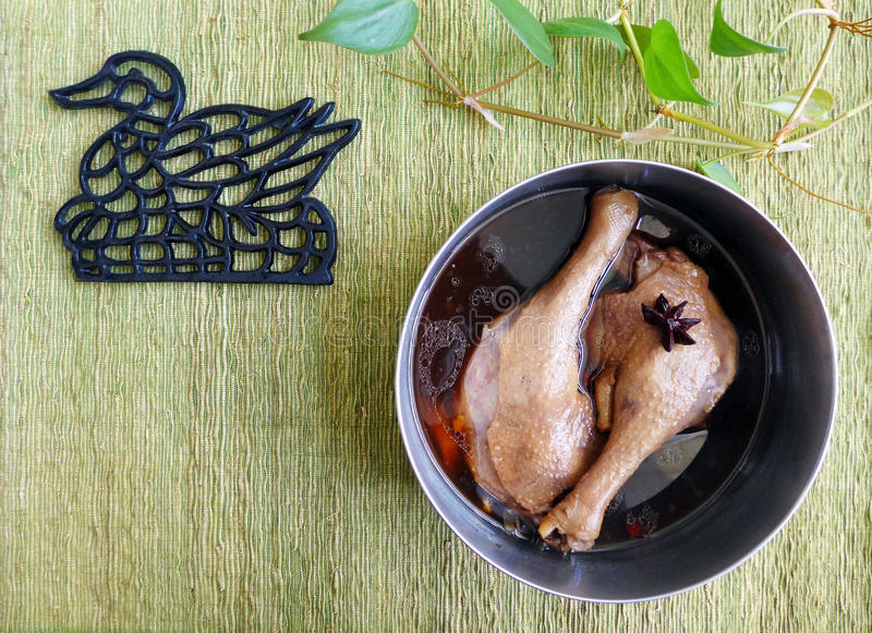 Cooking asian cuisine, Braised duck leg royalty free stock photos