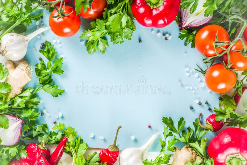 Cooking background with fresh vegetables and herbs stock photos
