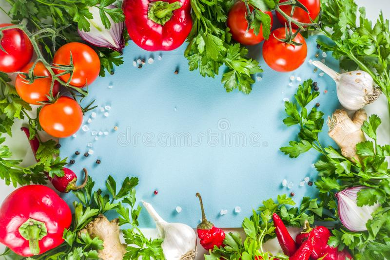 Cooking background with fresh vegetables and herbs. Healthy clean eating vegetarian food, diet nutrition concept. Various fresh veggie ingredients for salad or stock image