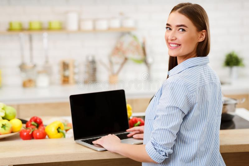 Cooking Blog. Woman Searching Recipes Online On Laptop royalty free stock images