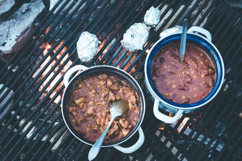 Cooking on bonfire: Tasty stew on a camping trip royalty free stock photos
