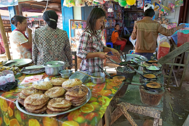 Cooking. Burmese woman is cooking food at the market in Pindaya, Myanmar or Burma royalty free stock photos