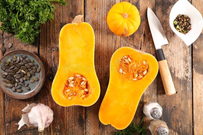 Cooking butternut. On wood background stock photos