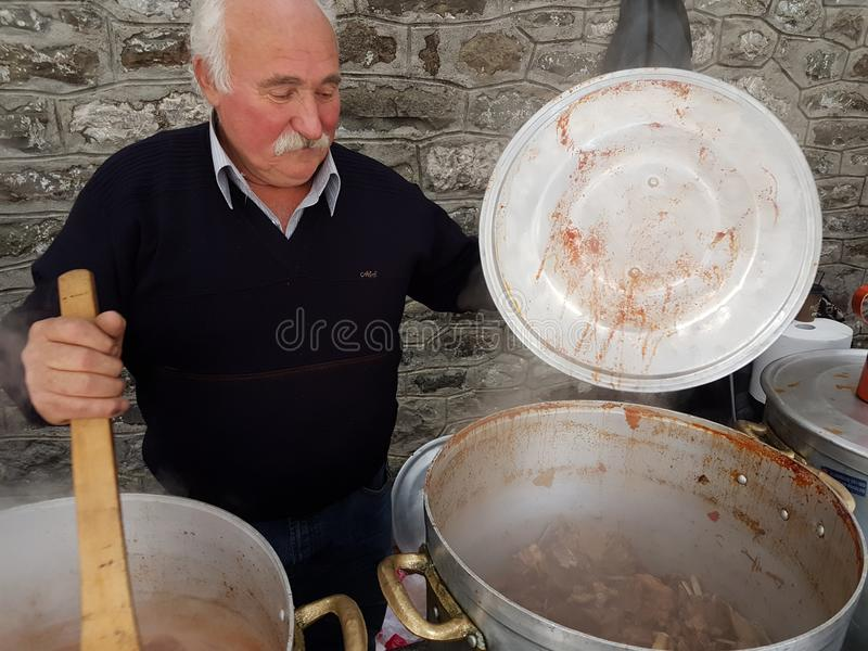 Cooking in cauldron for carnival event of village Kipseli Arta stock photography