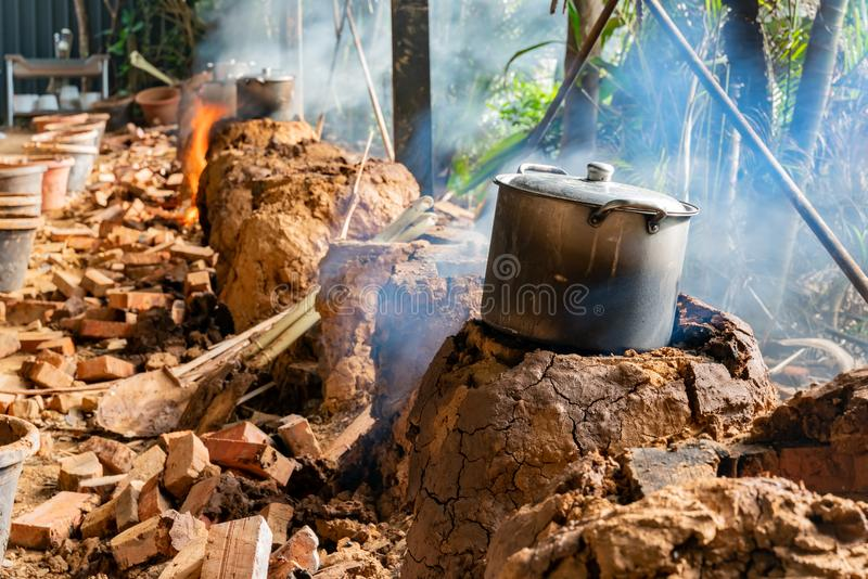 Cooking with char kiln and a pot. In a farming resort at Taoyuan City, Taiwan stock image