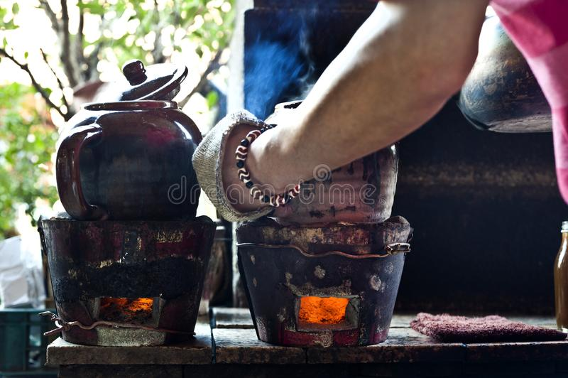Cooking Chinese herbal medicine. Using coal and clay pots royalty free stock image