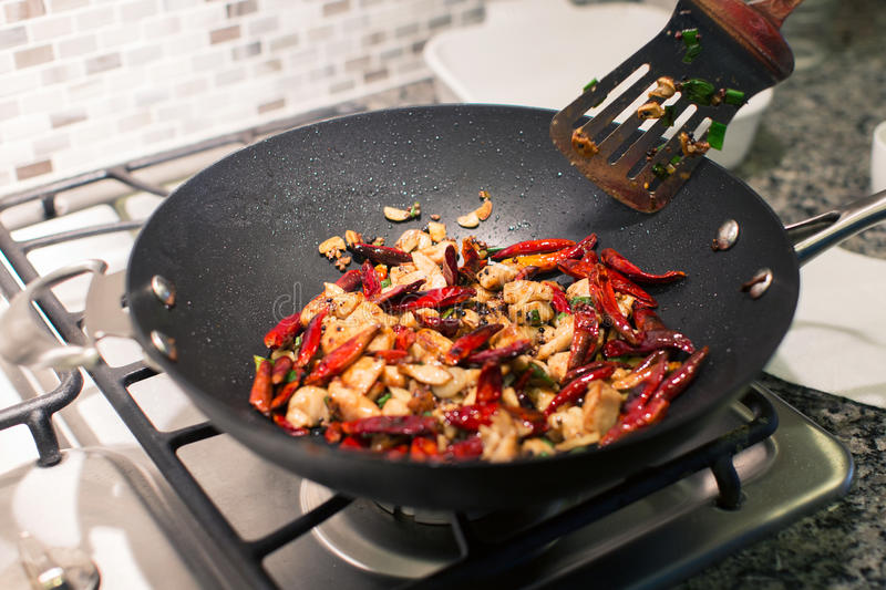 Cooking chongqing chicken. In wok at home, traditional szechuan (sichuan) chinese meal royalty free stock photos