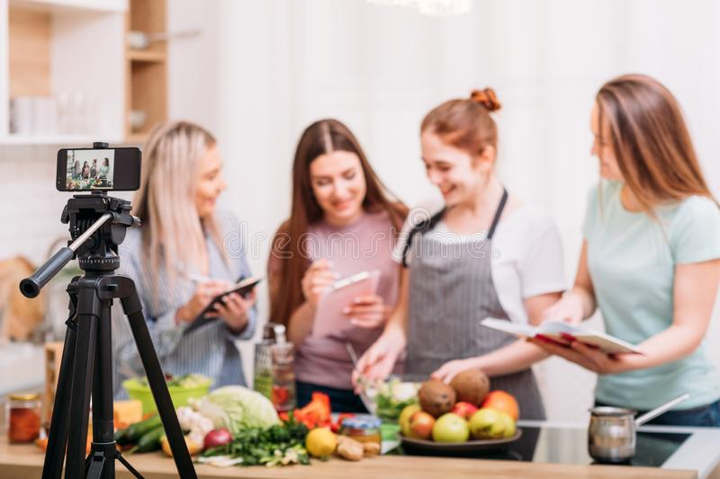 Cooking class food blog video tutorial phone women royalty free stock photos