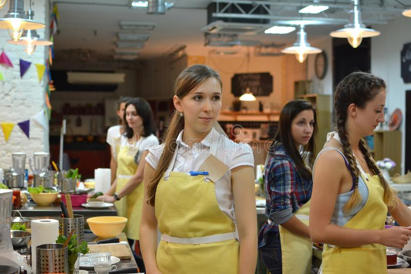 Cooking class. young happy women in kitchen stock image
