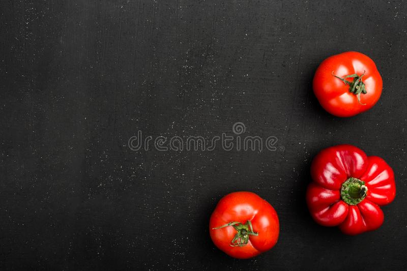 Cooking concept - red pappers and tomatos on stone table. Set of healthy food products are sources of vitamins and minerals stock image