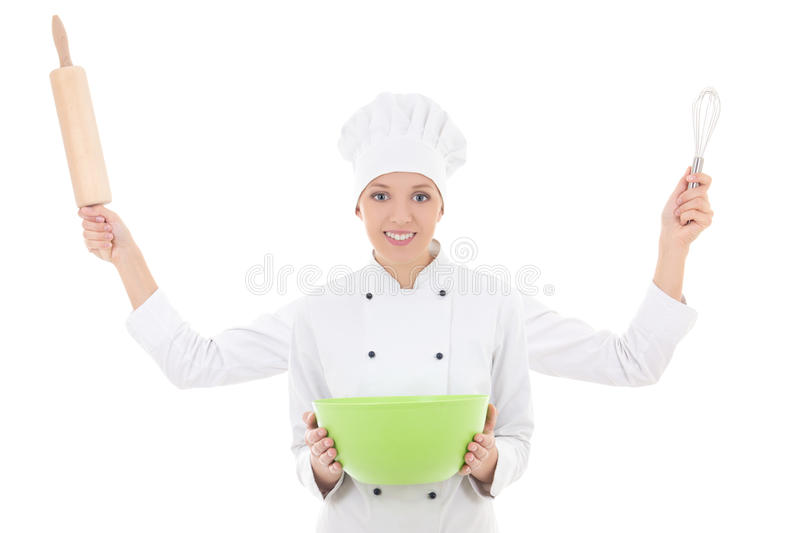 Cooking concept - woman in chef uniform with four hands holding. Rolling pin, whisk and bowl isolated on white background stock photos