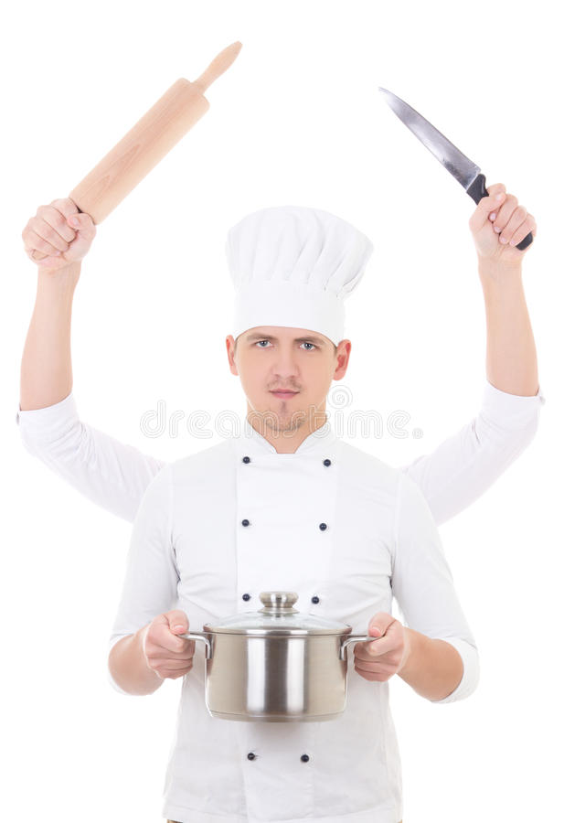 Cooking concept -young man in chef uniform with four hands holding kitchen equipment. Isolated on white stock photography