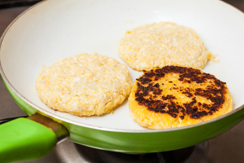 Cooking the corn bread on a pan royalty free stock photography