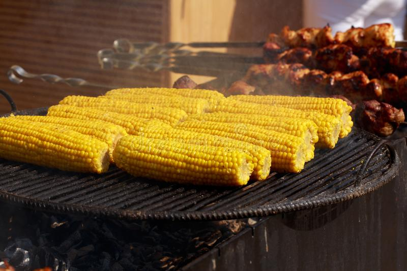 Cooking corn on the grill stock photography
