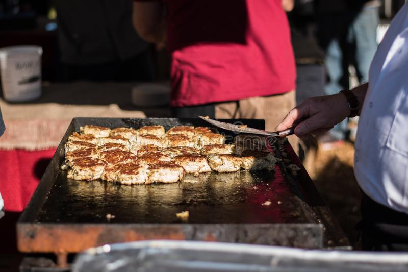 Cooking Crab Cakes on a Grill royalty free stock photos