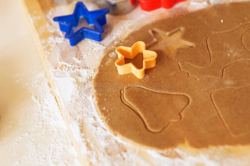 Cooking and decorating christmas gingerbread cookies. Cooking and decorating christmas gingerbread. Homemade gingerbread cookies, forms and baking ingredients royalty free stock image