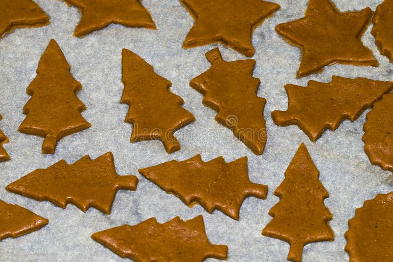 Cooking and decorating christmas gingerbread. Homemade gingerbread cookies, forms and baking ingredients.  stock image