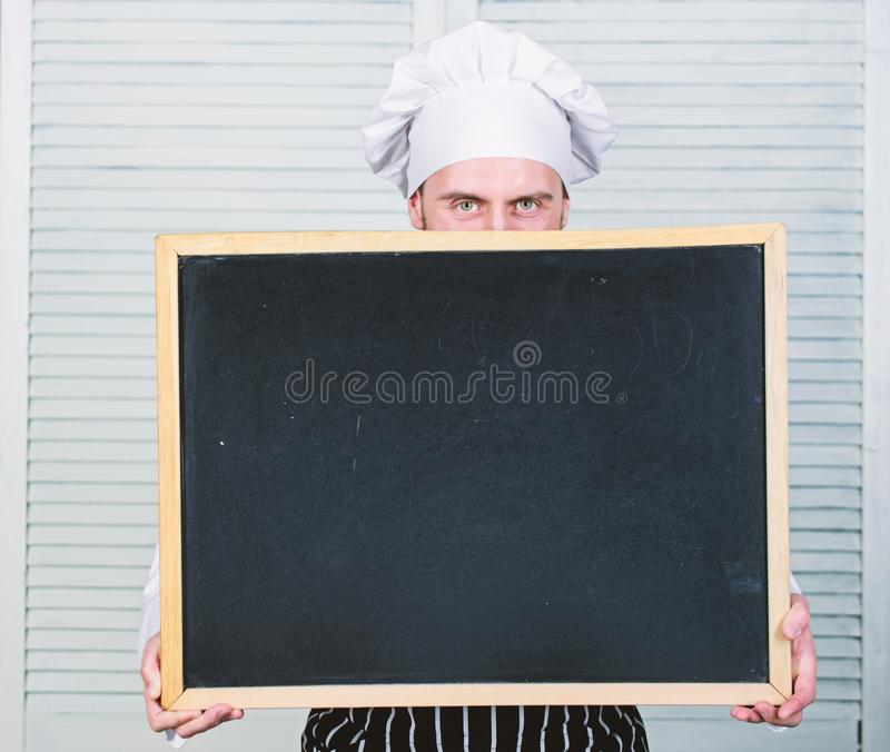 Cooking delicious meal step by step. Menu for today. List ingredients for cooking dish. Check out cooking tips. Tips to. Cook like pro. Man chef hat apron hold royalty free stock images