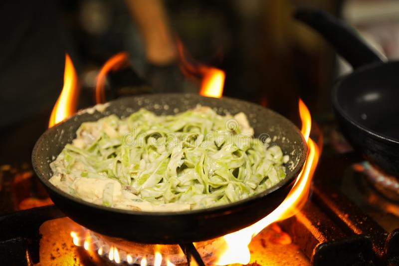 Cooking delicious noodles with melted  on frying pan royalty free stock photography