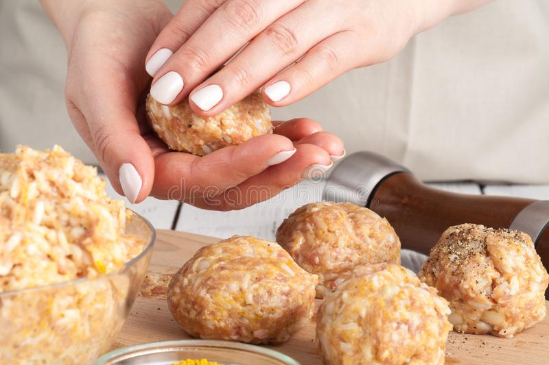 Cooking diet chicken meatballs for healthy dinner royalty free stock image
