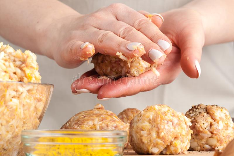 Cooking diet chicken meatballs for healthy dinner royalty free stock images