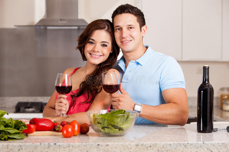 Cooking and drinking some wine stock image