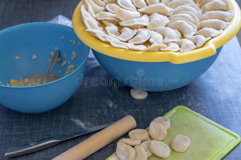 Cooking, dumplings raw with potatoes, table with ingredients potatoes, dough and flour ingredients for cooking dumplings stock photos