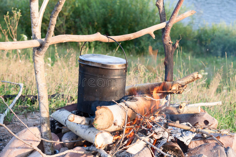 Cooking eat in bowler on the fire in hike stock images