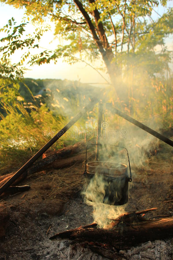 Cooking eat in bowler on the fire. Summer time stock photo