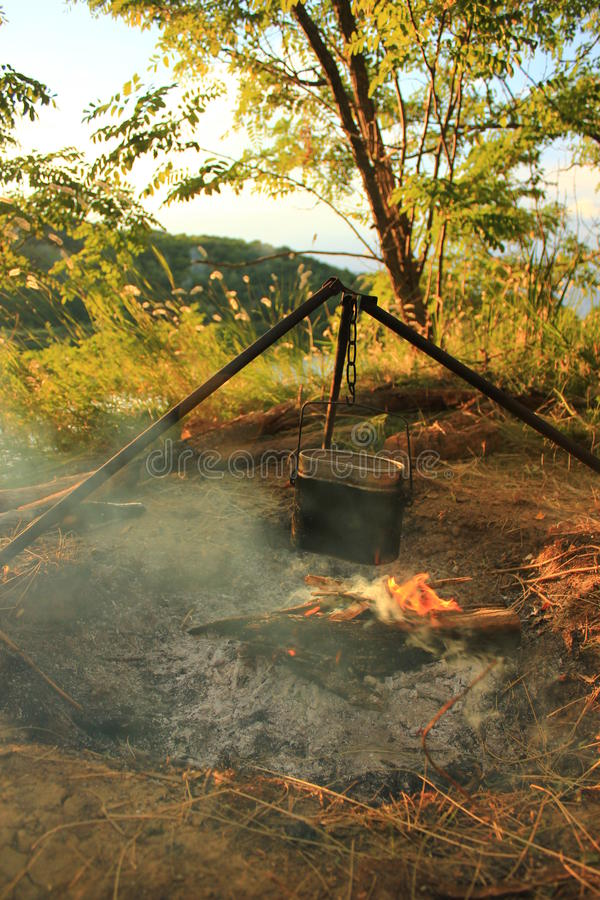 Cooking eat in bowler on the fire. Summer time stock image
