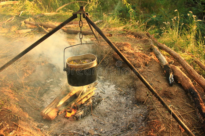 Cooking eat in bowler on the fire. Summer time royalty free stock photos