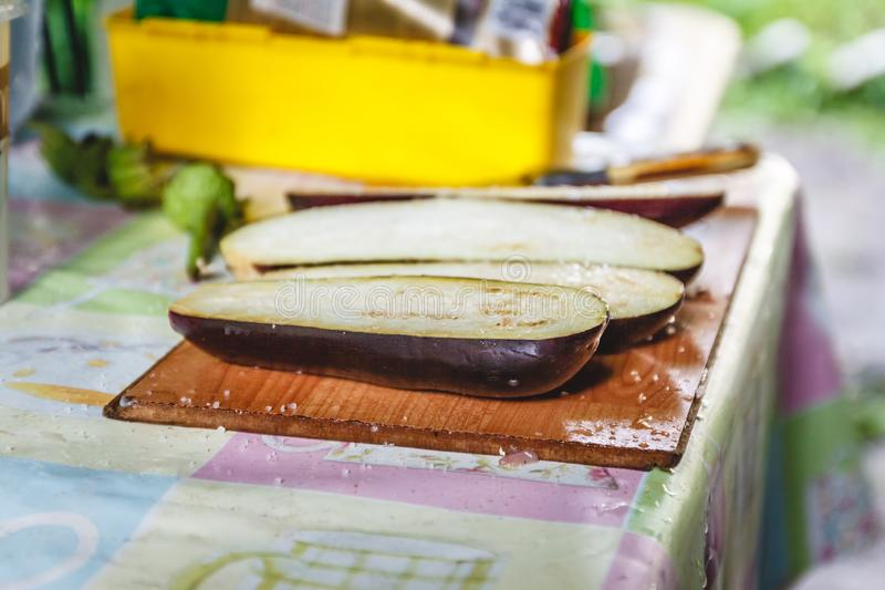 Cooking eggplant, sliced and salted. The concept of healthy and simple food, veganism royalty free stock photography