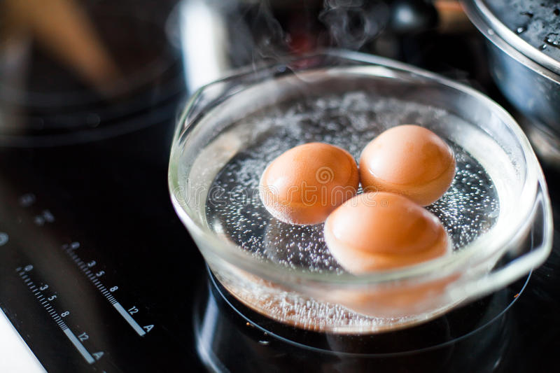 Cooking eggs stock image