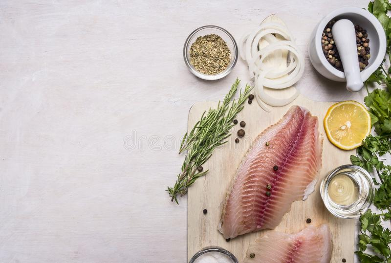 Cooking fish with herbs, butter and lemon, and pepper in mortar border place for text . royalty free stock images